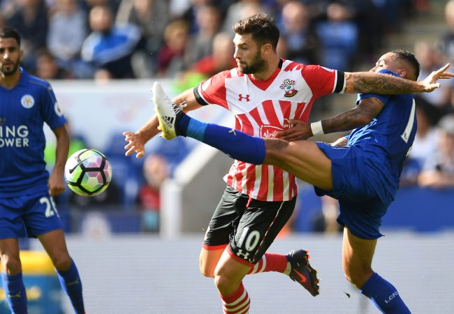 LEICESTER, ENGLAND - OCTOBER 02: Charlie Austin of Southampton (C) is tackled by Danny Simpson of Leicester City (R) during the Premier League match between Leicester City and Southampton at The King Power Stadium on October 2, 2016 in Leicester, England. (Photo by Laurence Griffiths/Getty Images)