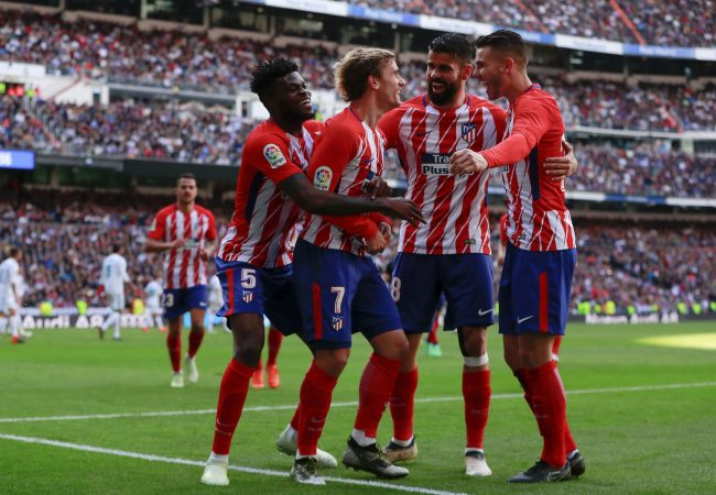MADRID, SPAIN - APRIL 08: Antoine Griezmann (2ndL) of Atletico de Madrid celebrates scoring their opening goal with teammates Thomas Teye Partey (L), Diego Costa (2ndR) and Lucas Hernandez (R) during the La Liga match between Real Madrid CF and Club Atletico de Madrid at Estadio Santiago Bernabeu on April 8, 2018 in Madrid, Spain. (Photo by Gonzalo Arroyo Moreno/Getty Images)