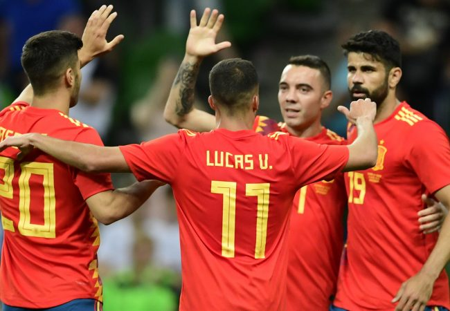 Spain's forward Iago Aspas (3rd L) celebrates after scoring a goal against with Spain's midfielder Marco Asensio (L), Spain's midfielder Lucas Vazquez (2nd L) and Spain's forward Diego Costa (4th L) during the friendly football match between Spain and Tunisia at Krasnodar's stadium on June 9, 2018. (Photo by PIERRE-PHILIPPE MARCOU / AFP)        (Photo credit should read PIERRE-PHILIPPE MARCOU/AFP/Getty Images)