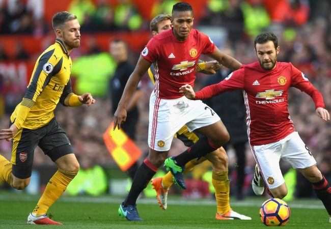 MANCHESTER, ENGLAND - NOVEMBER 19:Juan Mata of Manchester United (R) attempts to take the ball past Aaron Ramsey of Arsenal (L) during the Premier League match between Manchester United and Arsenal at Old Trafford on November 19, 2016 in Manchester, England. (Photo by Shaun Botterill/Getty Images)